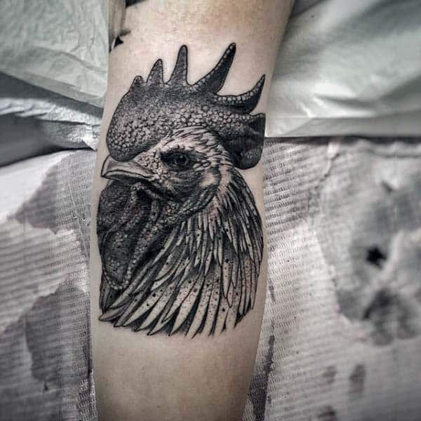 Man With Proud Rooster Tattoo On Forearm In Blackwork