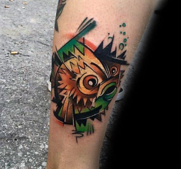 Man With Puffer Fish Tattoo Design