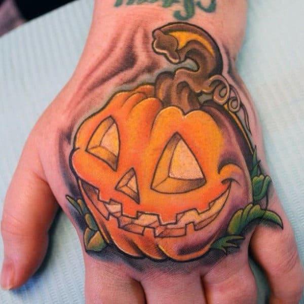 Man With Pumpkin Tattoo On Hand