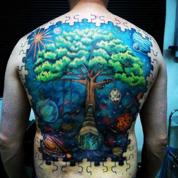 Man With Puzzle Piece Back Tattoo In Full Color Ink