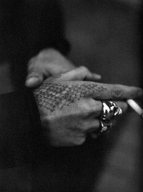 Man With Rattlesnake Skin Hand Tattoo