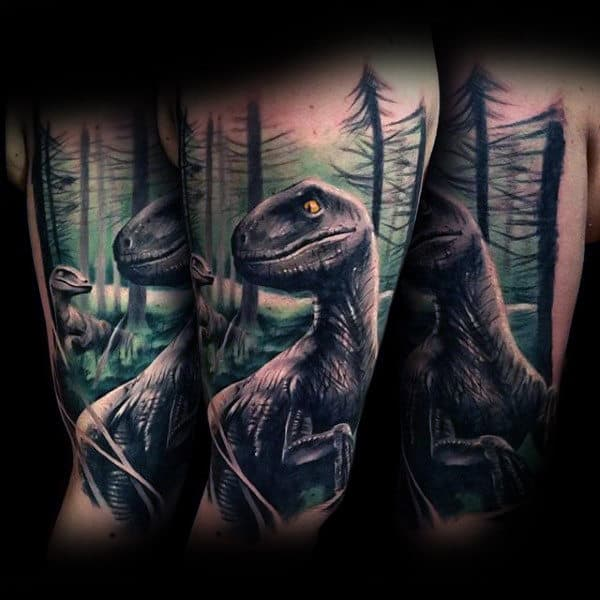 Man With Realistic Dinosaurs And Trees Tattoo On Forearms
