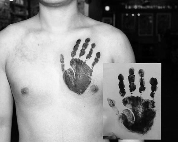 Man With Realistic Handprint Black Ink Tattoo On Upper Chest