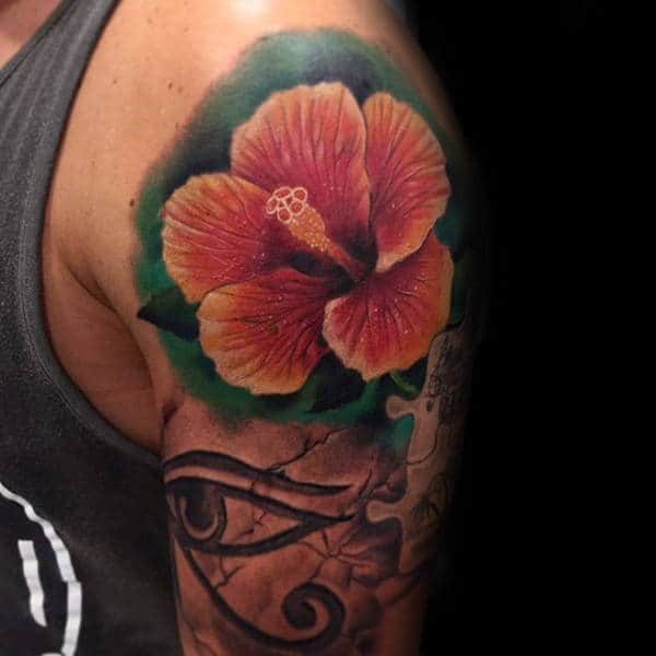 Man With Realistic Hibiscus Flower Tattoo On Upper Arm
