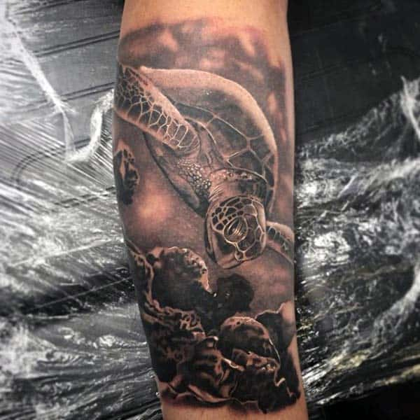Man With Realistic Turtle In Water Forearm Tattoo