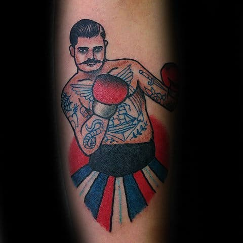 Man With Red White And Blue Traditional Boxer Tattoo On Forearm