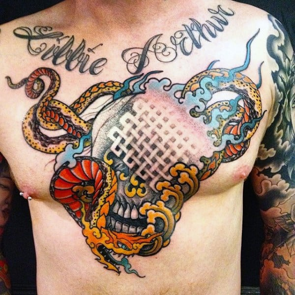 Man With Religious Snakes And Tails Tattoo On Chest