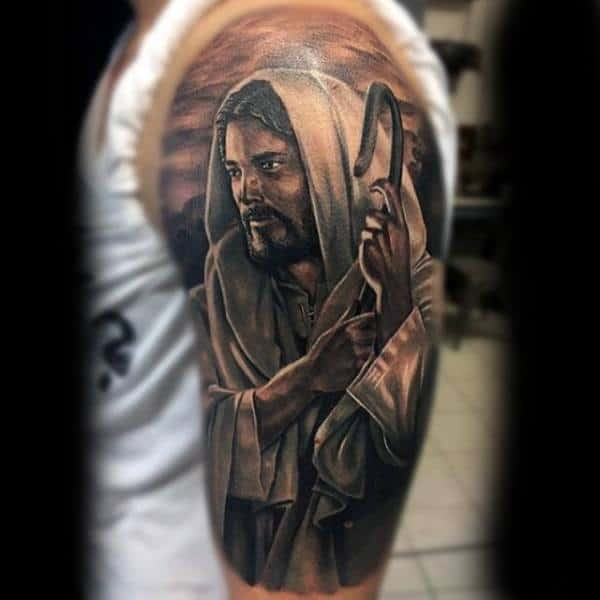 Man With Religious Veiled Lord Tattoo On Sleeves