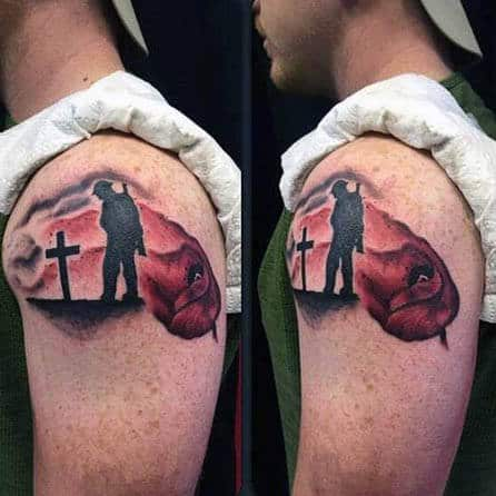 Man With Remembrance Poppy Tattoo On Upper Arm