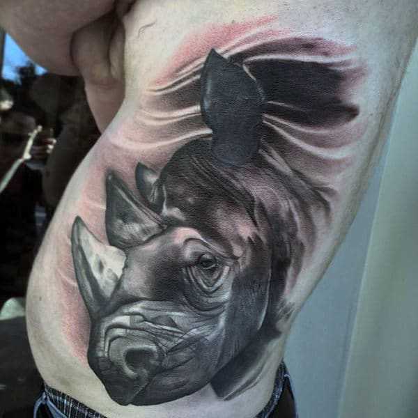 Man With Rhino Grey And Black Ribs Tattoo