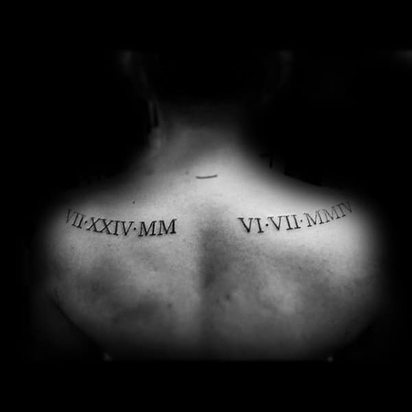 Man With Roman Numeral Tattoos On Upper Shoulders