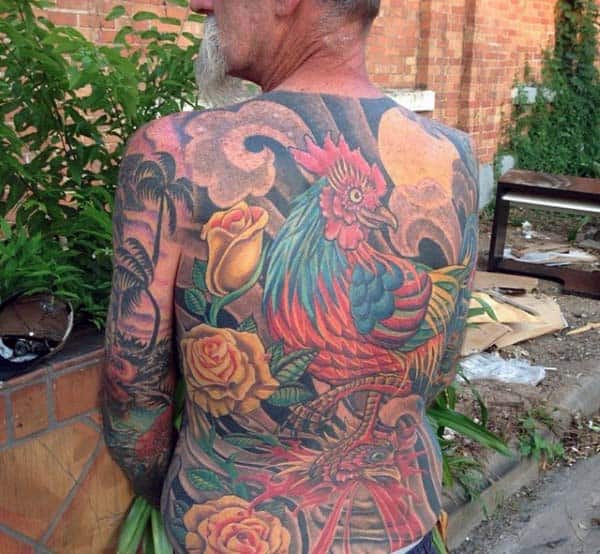 Man With Rooster And Flower Tattoo On Back In Traditional Style