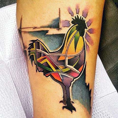 Man With Rooster Tattoo On Calf In Abstract Style