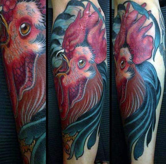 Man With Rooster Tattoo On Forearm Blue Nd Red Ink