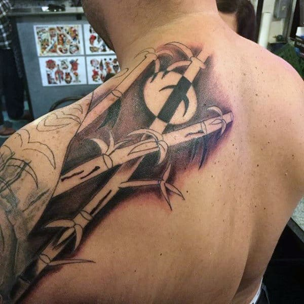 Man With Shaded Bamboo Back Tattoo