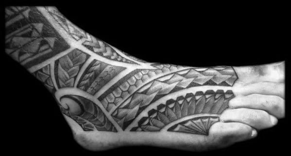 Man With Shaded Black And Grey Polynesian Foot Tattoo