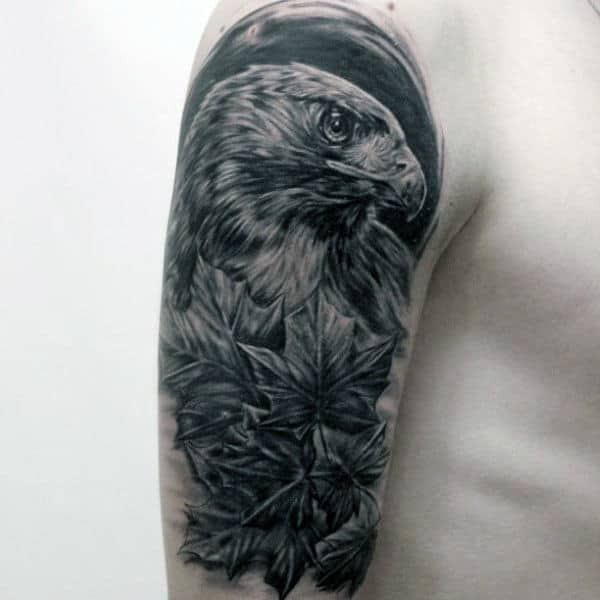 Man With Shaded Hawk Tattoo On Upper Arm