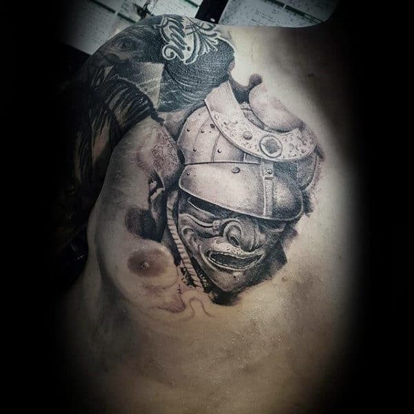 Man With Shaded Samurai Mask Chest Piece Tattoo