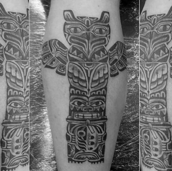 Man With Shaded Totem Pole Calf Tattoo