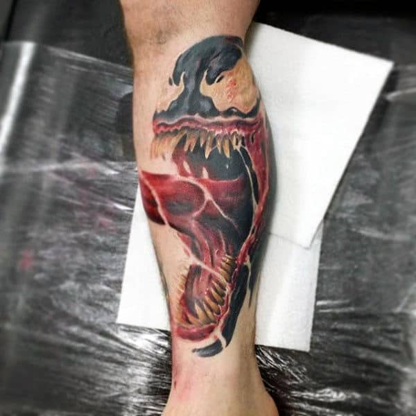 Man With Shin Tattoo Of Scary Creature