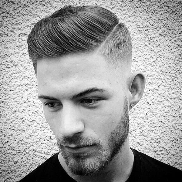 Man With Short Comb Over Skin Fade Haircut