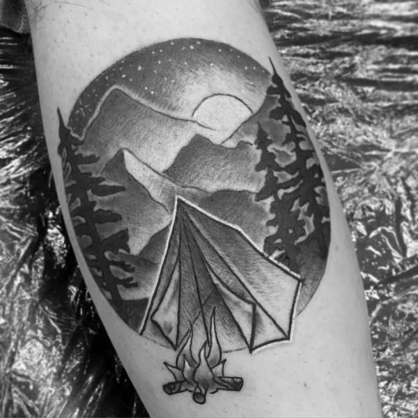 Man With Simple Campsite In Forest Bicep Tattoo