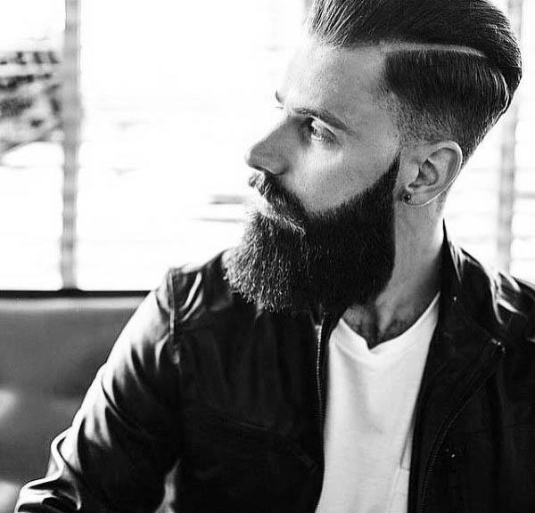 Man With Simple Hard Part Hairstyle And Low Fade