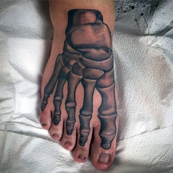 Man With Skeletal Bones Tattoo On Foot