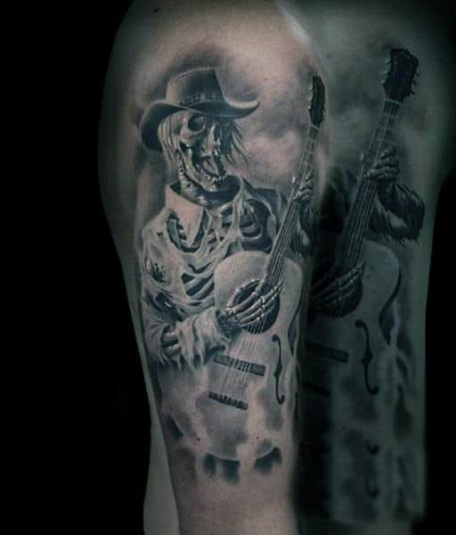 Man With Skeleton Playing Guitar Tattoo On Shoulders