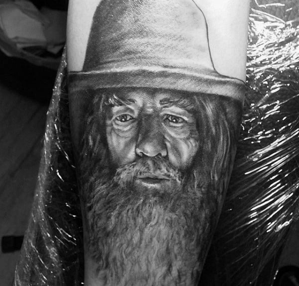 Man With Sketched Gandalf Lord Of The Rings Tattoo On Arm