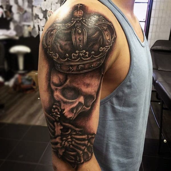 Man With Skull And Noble Crown Tattoo Biceps