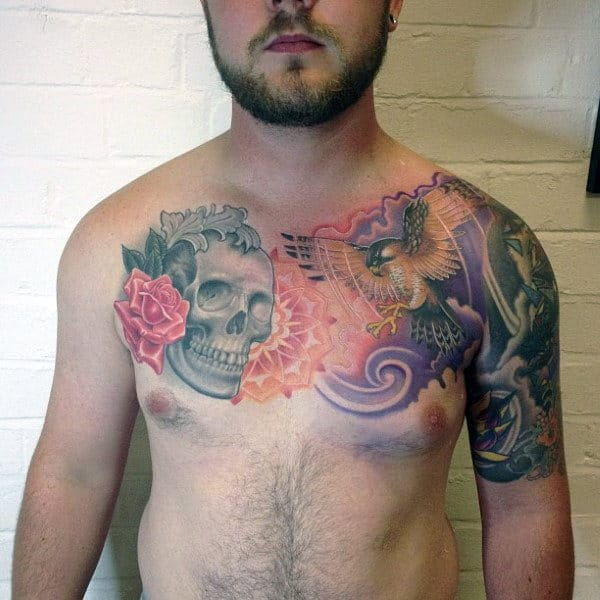 Man With Skull Falcon Chest Tattoos