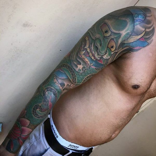 Man With Sleeve Tattoo Of Hannya Mask