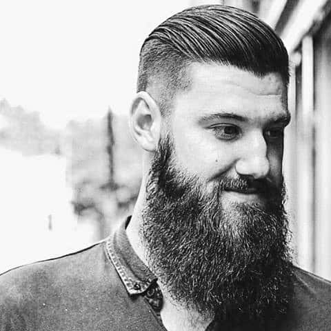 Man With Slicked Back Hair Undercut And Beard