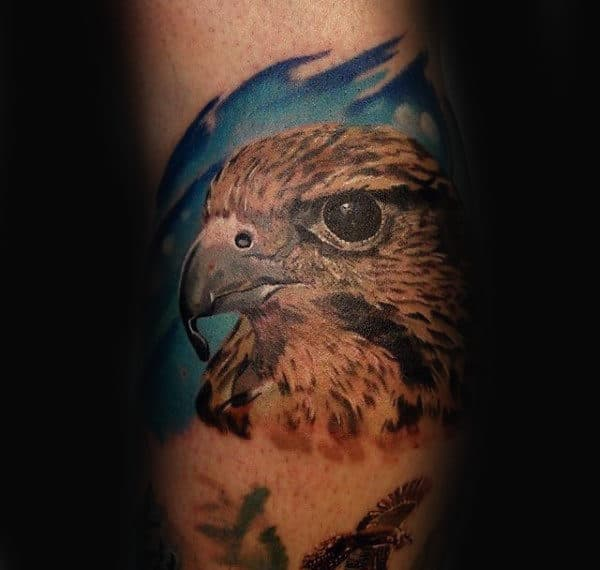 Man With Small Falcon Realistic Tattoo
