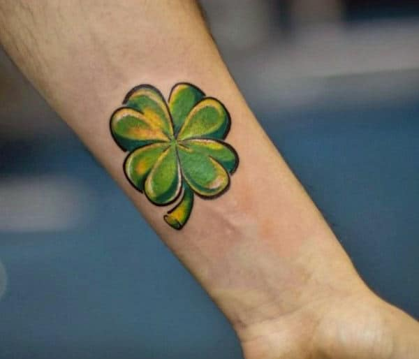Man With Small Simple Lucky Green Four Leaf Clover Wrist Tattoo