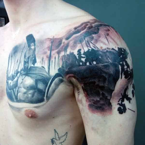 Man With Spartan Tattoo On Shoulder