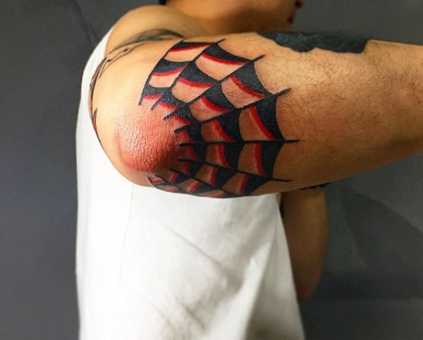 Man With Spider Web Sailor Jerry Black And Red Ink Tattoo On Elbow