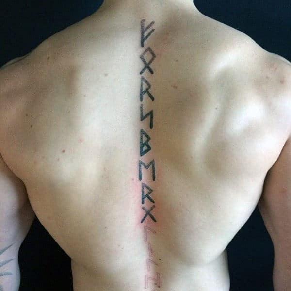 Man With Spine Rune Tattoo