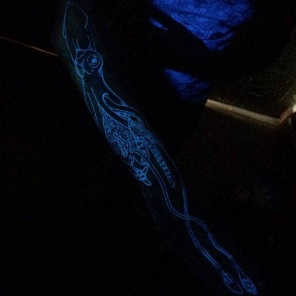 Man With Squid Glow In The Dark Tattoo Sleeve