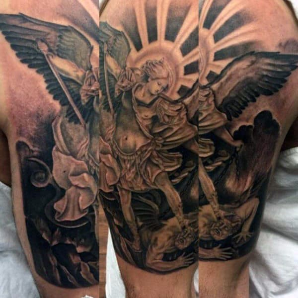 Man With St Micheal Sleeve Tattoo