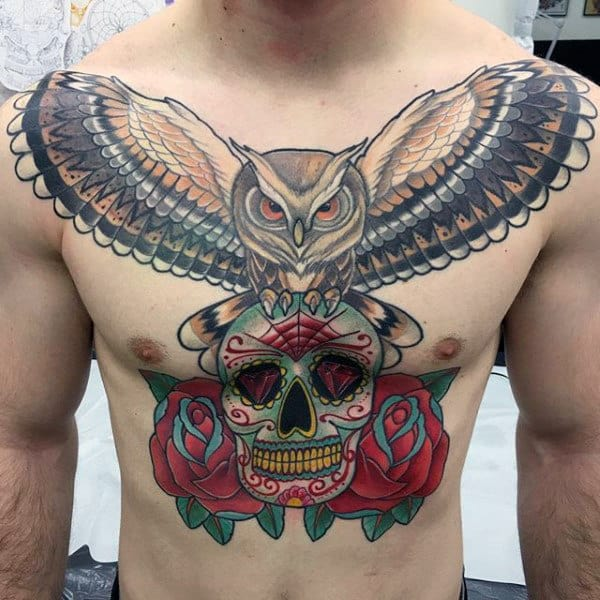 Man With Sugar Skull Tattoo On Chest With Owl And Roses
