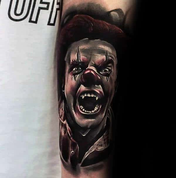 Man With Tattoo Of Angry Clown On Arms