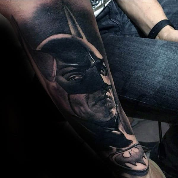 Man With Tattoo Of Batman In Black Ink On Forearm