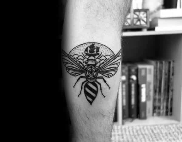 Man With Tattoo Of Bee On Leg