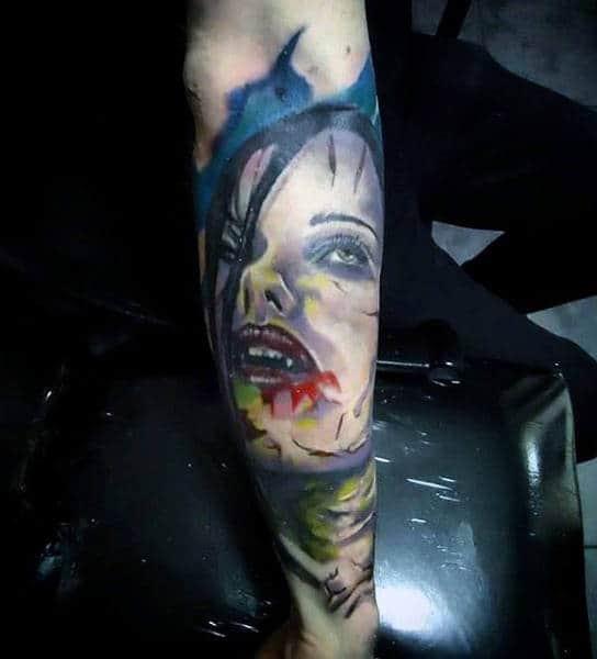 Man With Tattoo Of Female Vampire Half Sleeve Design