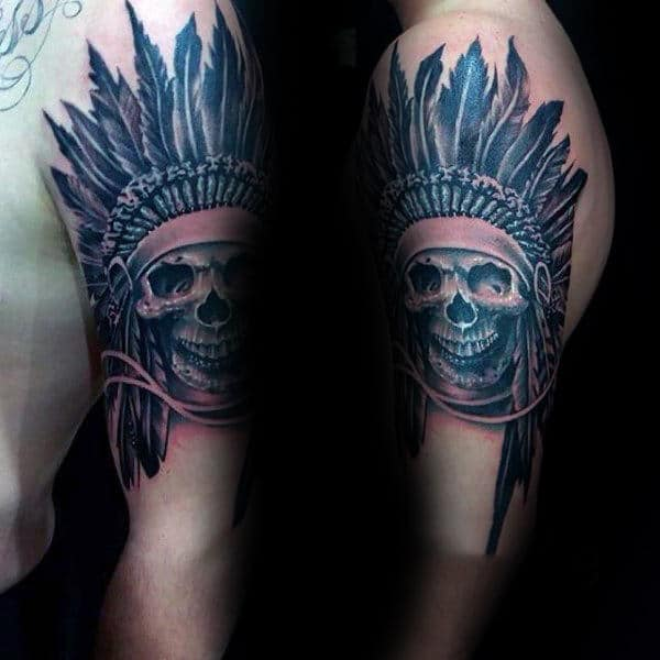 Man With Tattoo Of Indian Skull On Upper Arm