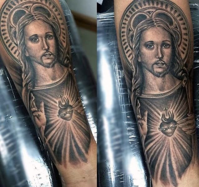Man With Tattoo Of Jesus Portrait And Sacred Heart On Inner Forearm