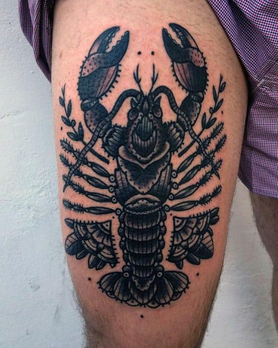 Man With Tattoo Of Old School Lobster Design On Thigh