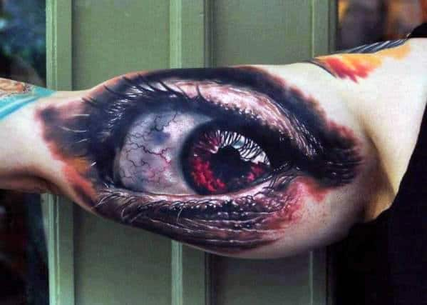 Man With Tattoo Of Realistic Optical Illusion Eye On Bicep